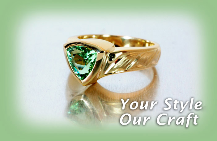 Custom made ring with green tourmaline and hand engraved detail
